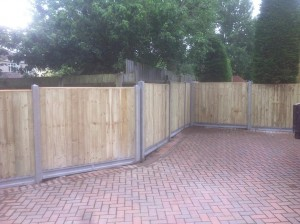 Closeboard fence panels with concrete posts in Bristol garden